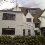 Rear elevation showing the surgery block with flat roof - the ugly roofline was one of the reasons the client instigated the project