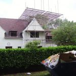 The scaffolding goes up for the roof work ...