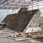 Deconstruction of the original roof - the tiles are saved for the new roof so that the build is not obviously new