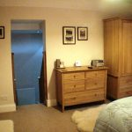 Guest suite showing stairs to dressing/en-suite area