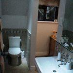 Guest suite - en-suite basin and loo, showing doorway to dressing area
